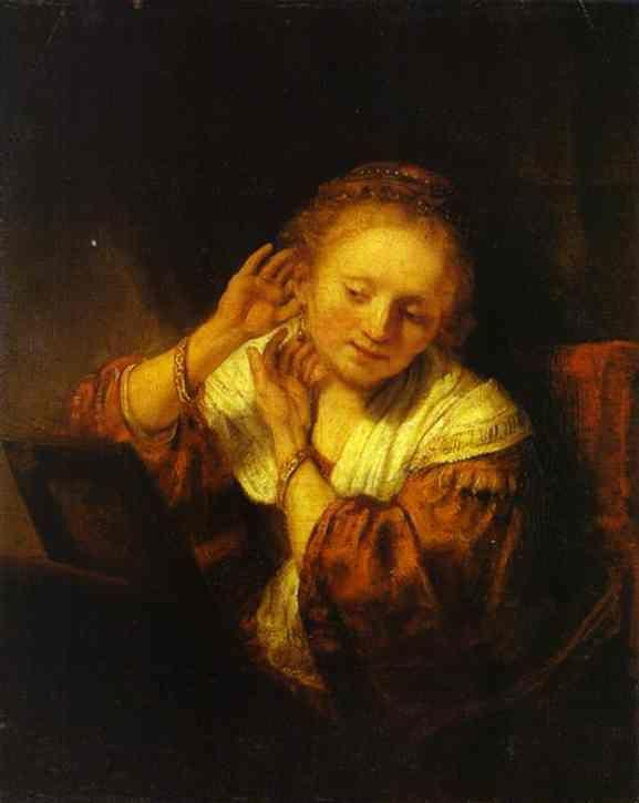 Rembrandt. A Young Woman Trying on  Earings.