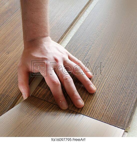 Free Art Print Of Man Laying Laminate Flooring Freeart Fa16097795